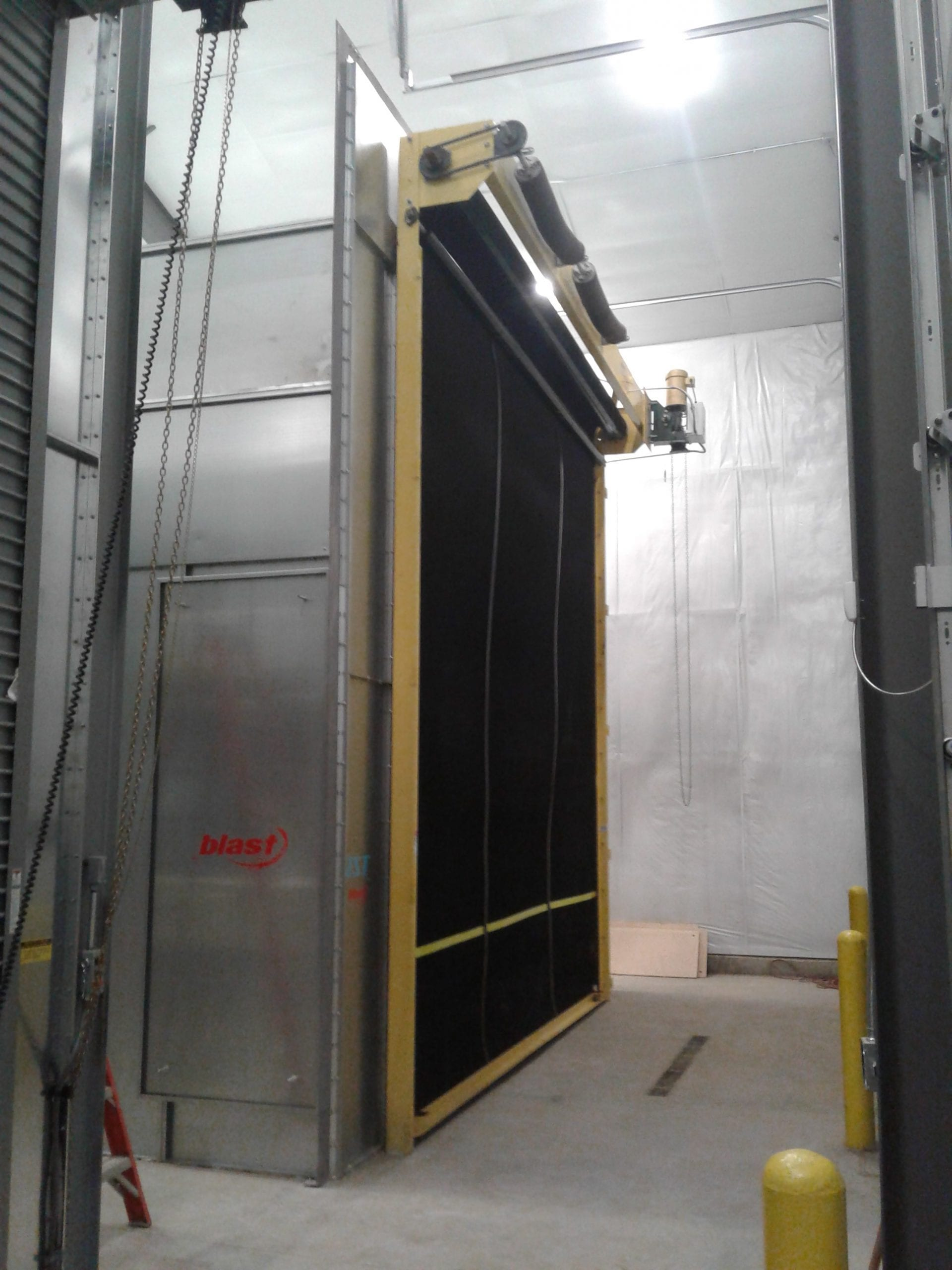 Blast Booth with Rubber Roll-Up Door Closed