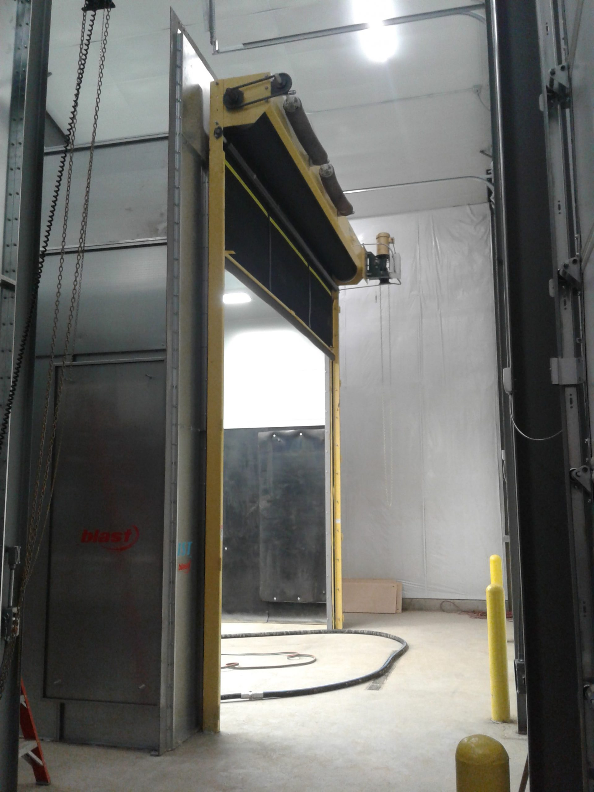 Blast Booth with Rubber Roll-Up Door Open