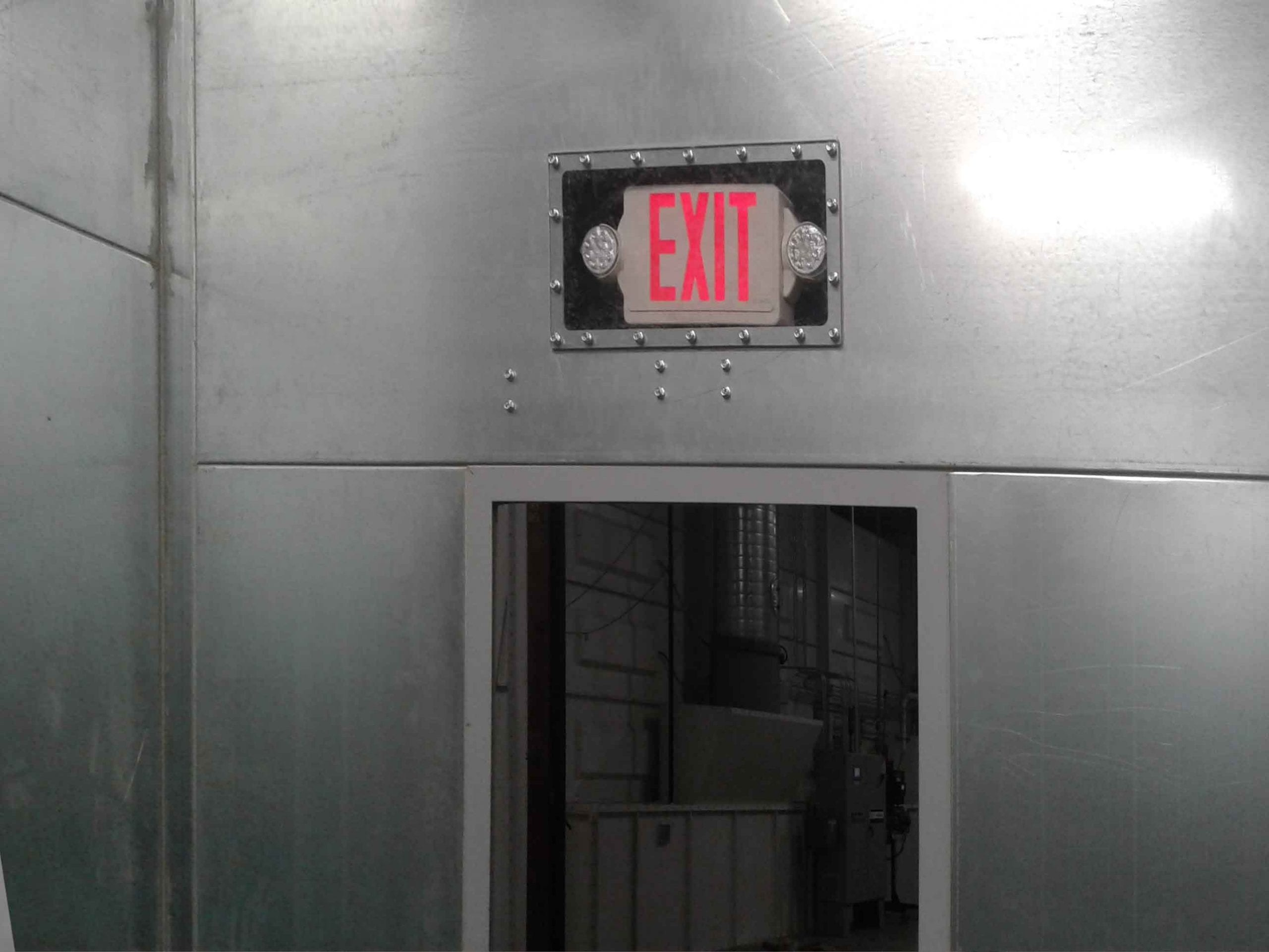 Illuminated Emergency Exit Sign on Sandblast Booth Personal Man Door
